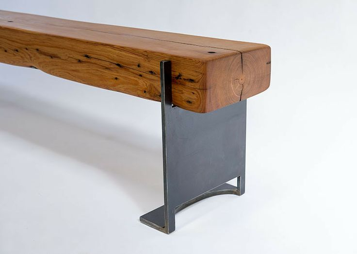 Indoor Bench (Piece # 53). This sleek indoor bench is constructed with a reclaimed timber and positioned atop steel bases that are hand forged from recycled steel. The bases are sealed with an oxidized patina. The bench is hand rubbed with oil to maximize the woods true character. #industrial #industrialdesign Industrial bench design