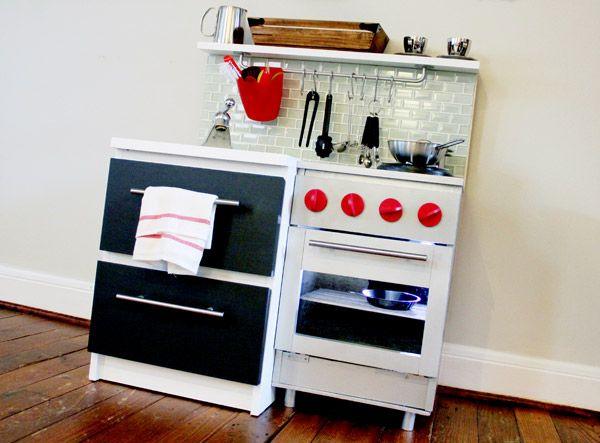 """gender neutral kitchen from Ikea parts--oh yes-- """"I made my two year old son a bitchin' kitchen, inspired by the likes of Bobby Flay, Tyler Florence, and Anthony Bourdain (who's kitchen I've never seen, but I can only imagine). The kid loves cooking SO much, I knew this would be a home run gift he would enjoy for years."""""""