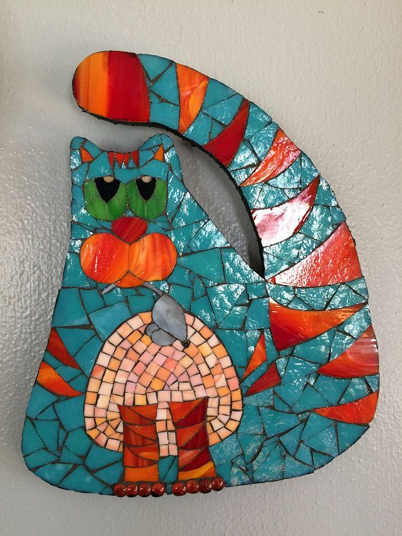 Original handcrafted stained glass mosaic. Each piece,of glass is hand cut and applied individually. The colors are much prettier in person, and especially brilliant in the sun. Glitter has been added to the grout for more pizzazz.