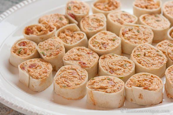 Shredded chicken, cream cheese, taco seasoning, rotel, and mexican cheese- all rolled up into lil servings! Mexi Rolls mmm