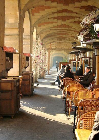 Arcades of the Place des Vosges in the Marais, Paris