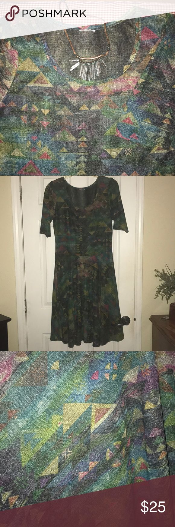Lularoe Nicole Dress The Nicole has a fitted bodice, a scoop neck dress that gives shape and style that naturally flatters all body types. Combining the fitted bodice with the flowy full circle skirt means that the Nicole has the perfect blend to dress up or dress down.It can be worn for any occasion.  This is a great abstract design. I cut the neck tag out because I like to wear the Nicole backwards! Try it for a higher neckline. It's fab! LuLaRoe Dresses