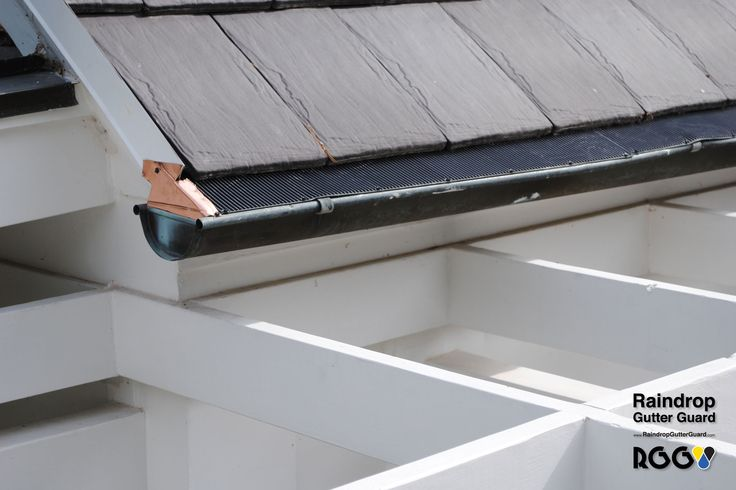 Copper Half Round Gutter with Raindrop Gutter Guard and a Slate Roof done by Cedar Roofing Company, LLC of Lake Forest, IL