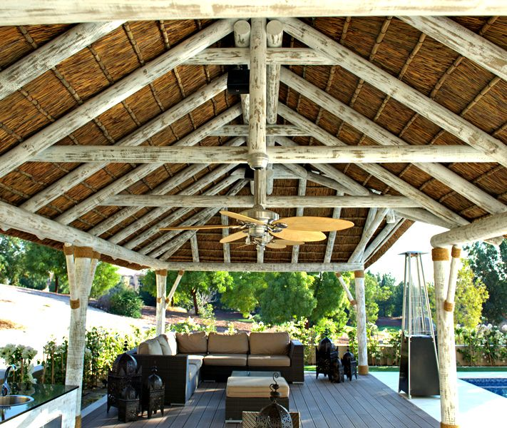 Modern whitewash thatched gazebo with plush outdoor seating and kitchen!