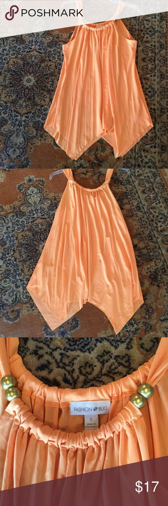 Spring/summer top Light orange, cantaloupe type color, double gold beads atop each side, long flowing angled v ends, very cute and pretty! 94% polyester 6% spandex, very fun! Fashion Bug Tops