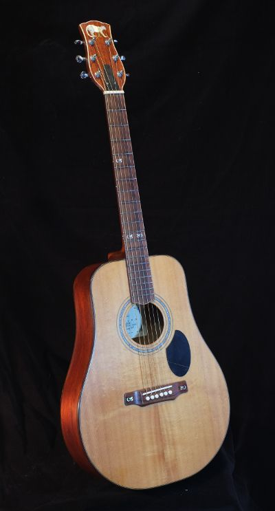 Parlour guitar with inlay of a cougar in the peg head.
