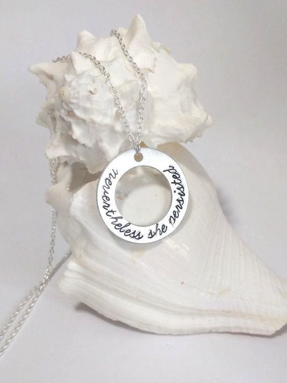 She was warned. She was given an explanation. Nevertheless, she persisted. This hand-stamped necklace features the quote Nevertheless, she persisted. Available in any of the fonts I currently offer (see listing picture) and in aluminum or sterling silver.  A portion of the proceeds from this necklace will be donated to the 501(c)3 non-profit ACTS (Action in Community Through Service), which funds our local emergency shelter, domestic violence shelter, sexual assault counseling and food…