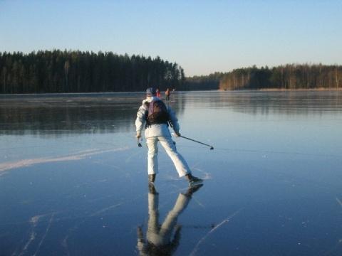 Ice skating in lake Saimaa