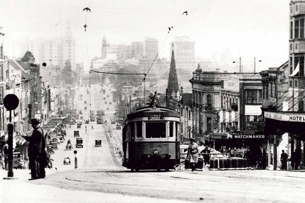 A tram travels up William Street towards Kings Cross in the 1930s.