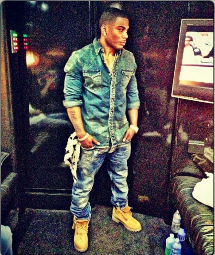Nelly (Hip Hop Rapper) wearing Timberland boots in a casual outfit.