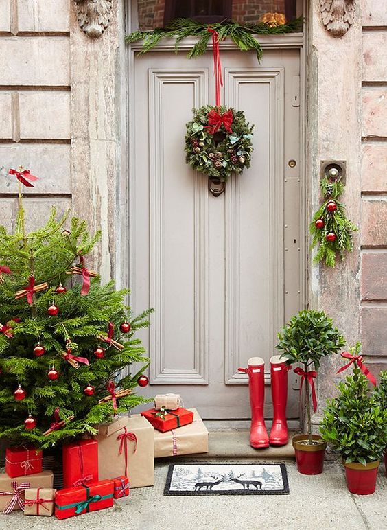 The French Bedroom Company | Get Guest Ready for Christmas over on the blog. Top Tips on organising your home for the festive season - not just christmas decorations, but thinking of chairs, spare bedroom ideas and inspiration for visiting pets. Festive front door and outside deocrations with red ribbon, red baubles, grey front door and miniature christmas tree ideas. Traditional Christmas wreath.
