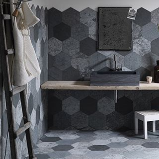 Lavagna is a natural stone tile in a contemporary hexagon shape! The mix of textures and neutral colors is what makes this stone tile so special.  .  .  .  #NewYorkDesign #BostonDesign #RedBankNJ #Philly #NemoTile