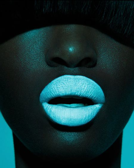 Wow image! Fantastic bright light blue lips, contrast with model's lovely chocolate-brown skin, bright turquoise background.