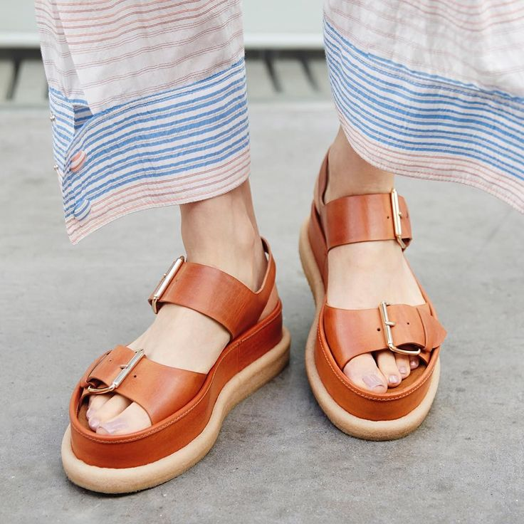 """Stella McCartney: """"Step into the new season with chunky buckle sandals in tones of praline, white and black."""