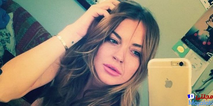Lindsay Lohan shares topless photo to celebrate opening of nightclub named after her