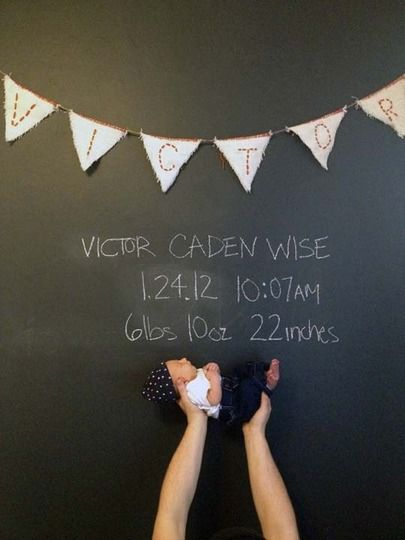 Awesome baby nursery with chalkboard wall and mural from Apartment Therapy