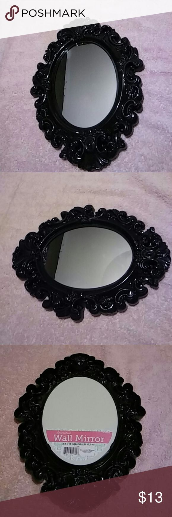 Black wall mirror Brand new black wall mirror measurements: Wall Mirror 9.6x13in(24.38x33.02cm) Other