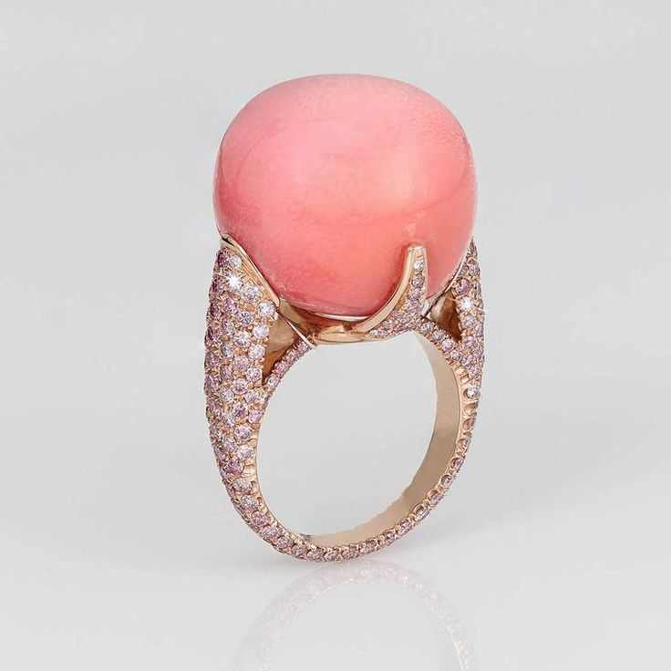 At 44.55 carats, the baroque pink conch pearl rising from the centre of this David Morris ring is one of the largest available to buy today. With pink sapphires in rose gold. What are conch pearls and why are they so rare? Find out more from the pink pearl that is featured in modern and vintage jewels http://www.thejewelleryeditor.com/jewellery/know-how/conch-pearls/ #jewelry