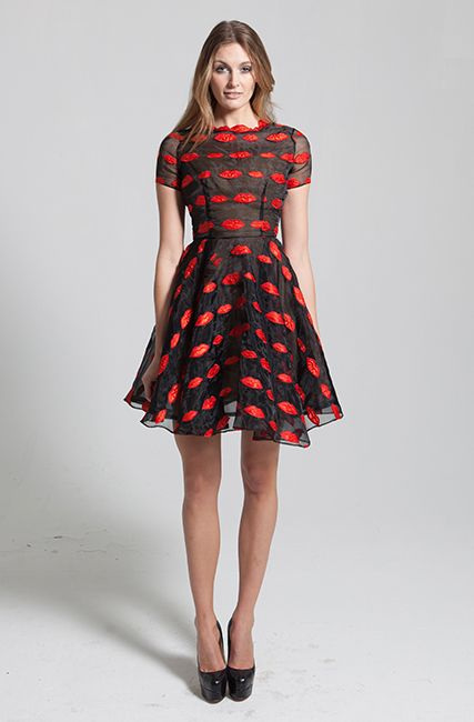 Red lips embroidered organza full skirt dress. The Daelyn dress is made of a black organza fabric, embroidered with red lips. This fun dress features shortsleeve and a red lip detailed neckline. It is designed to be fitted through the bodice and flare out at the skirt. #evening #cute #fun #girly #boldred #lippattern #lips #redlips #flaredskirt #flareddress #fundress #partydress #NARCES