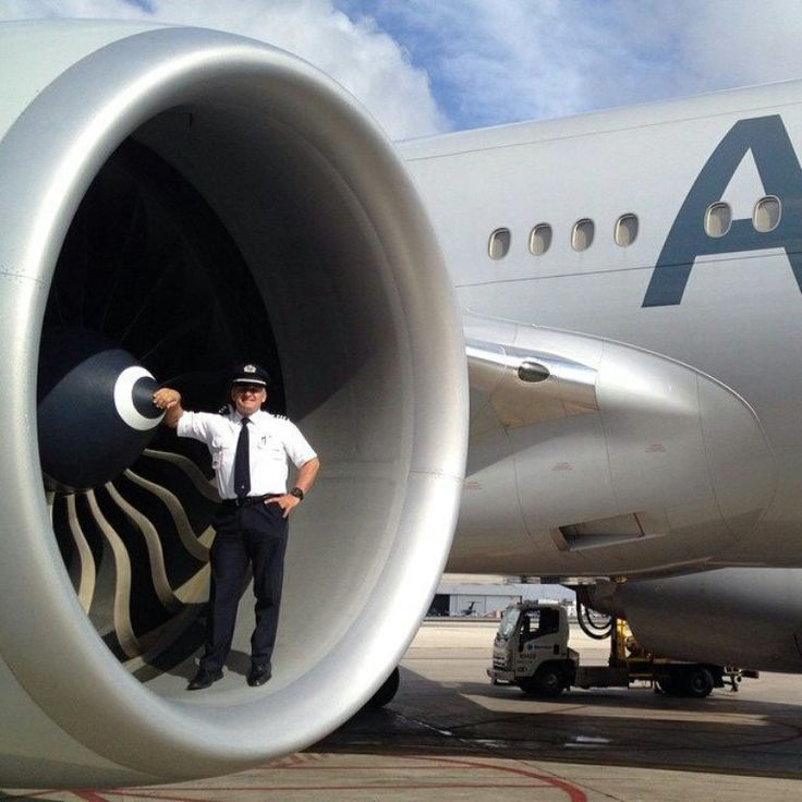 Pilot in the intake of a Rolls-Royce Trent 800 engine on a Boeing 777-200