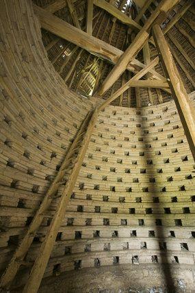 Inside the circular, fourteenth-century Kinwarton Dovecote near Alcester, Warwickshire