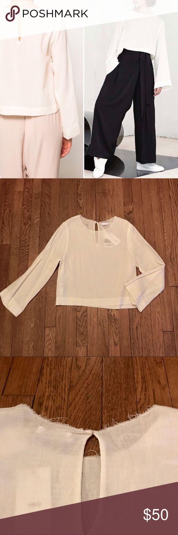 NWT •MANGO Spain Premium Coll. Flare-sleeve Blouse 🌟BRAND NEW w/TAGS! NEVER WORN🌟   🦋MANGO Barcelona Premium Collection  🦋Looks & feels beautiful! • silky-soft, lightweight material made of lush new wool blend • light cream color  🦋Slightly Boxy / Cropped style is very flattering & perfect with high waisted trousers, jeans, or skirts!  🦋Soft fraying around neckline adds a bit of edginess  🦋Chic sophistication — so versatile — easily transition from professional to more casual looks…