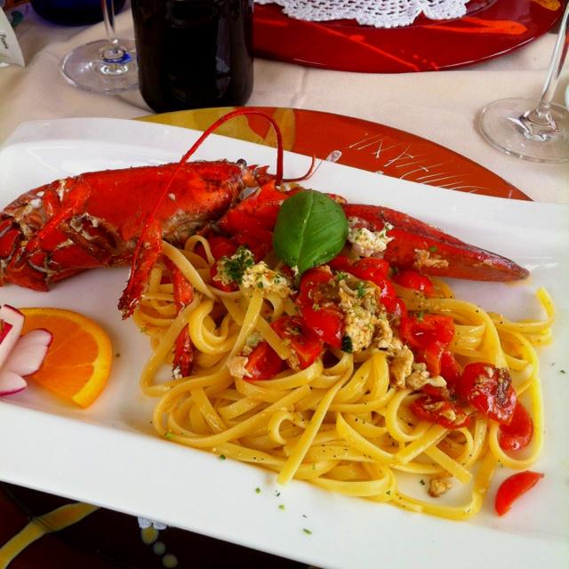 Red lobster, fresh tomato sauce, pasta.
