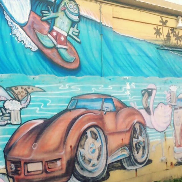 TGIF! I love the beach wall art found on the coast. This mural is on the side wall of an outdoor tiki bar spot right @cocoabeachpier. Where are you exploring this weekend? . . . . . #flipflopweekend #floridalife #igersflorida #visitflorida #loveflorida #s