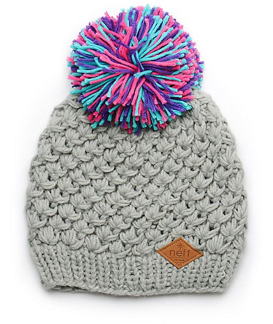 A slouchy fit beanie made with a chunky knit construction is finished with a colorful pom pom at top and a faux leather brand patch for an ultra fresh look.