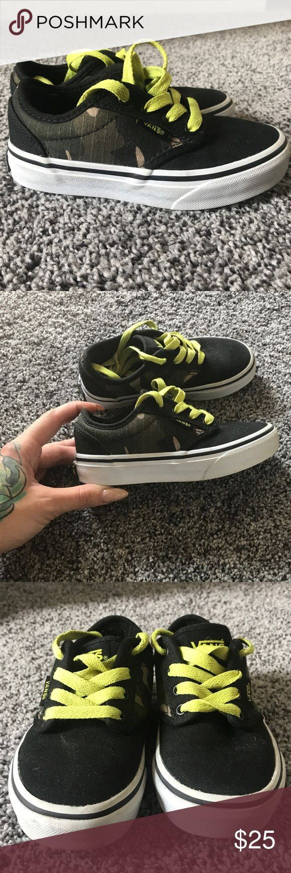 Boys Vans low top sneakers camo and black!! Boys Vans low top camo, black and neon green sneakers in a size 10.5. Excellent preowned condition, could use a magic eraser sole touch up but other than that, they're great and have tons of love left 🖤 I give awesome discounts on my kids gear! Just throw your likes into a bundle and I'll send you an offer just for you! 🎃 Vans Shoes Sneakers
