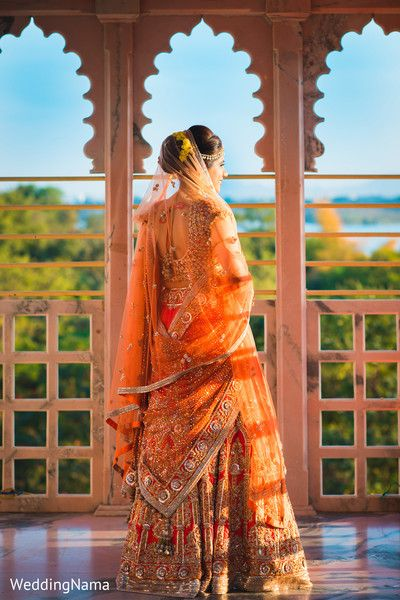 Portrait of indian bride in her wedding lengha. http://www.maharaniweddings.com/gallery/photo/82777