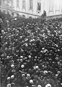 1918-A German republic is founded.-Philipp Scheidemann addresses a crowd from a window of the Reich Chancellery, 9 November 1918.