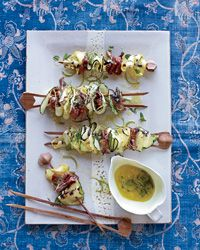 Grilling zucchini and summer squash ribbons on skewers is terrific because the edges become wonderfully charred and crisp, while the insides stay tender and juicy.