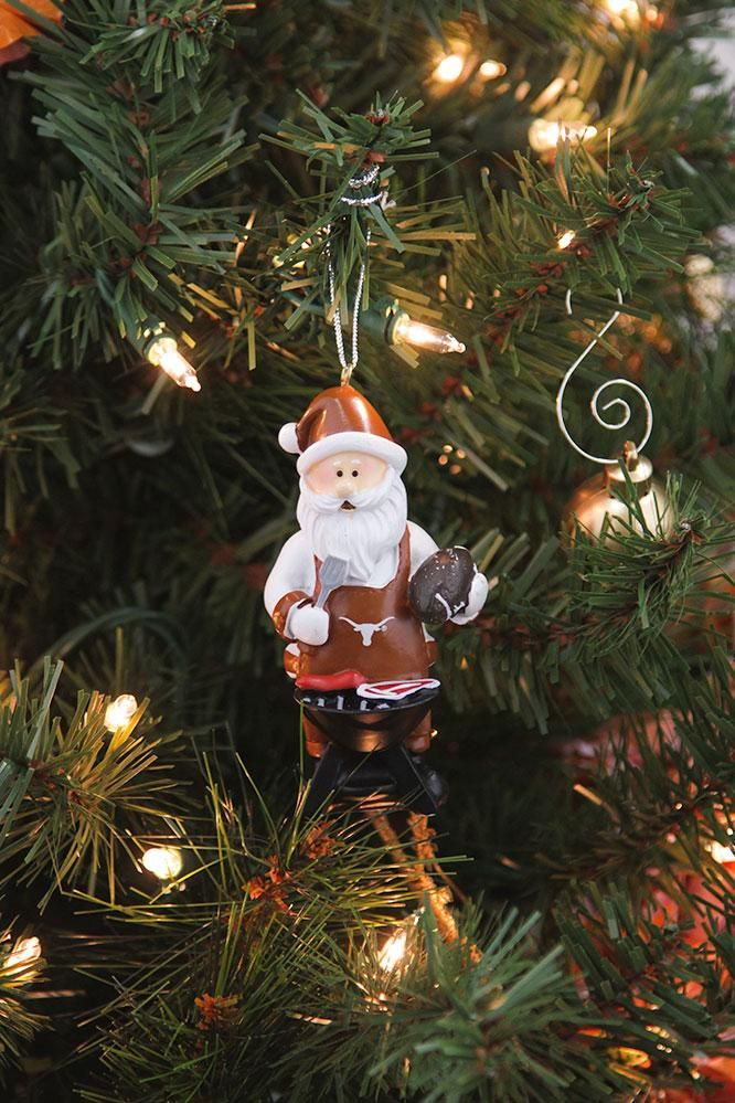 Kris Kringle is grilling! Invite BBQ Santa in for the holidays. This Christmas tree ornament will add Texas Longhorn touches to your holiday decor! Buy now!