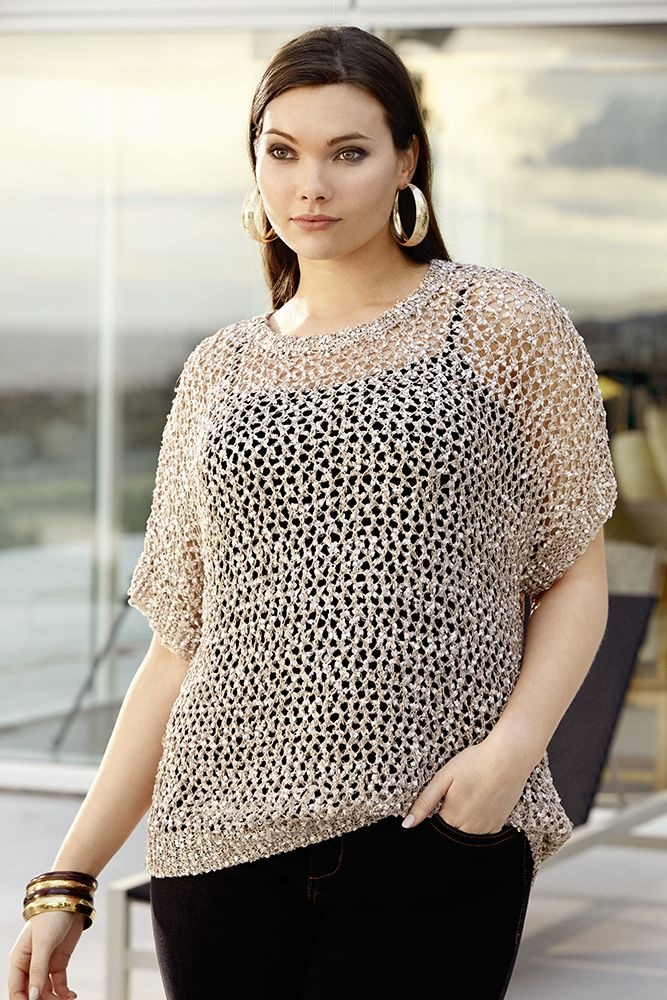 K&K plus size curvy fashion. Champagne knit top worn over a basic cami singlet and skinny jeans. Looks great with big accessories!