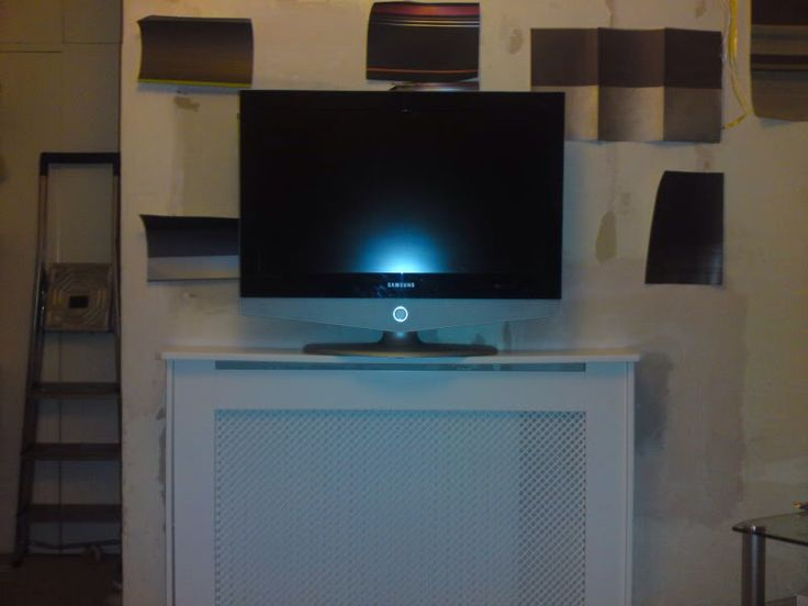 Work in progress. My wall mounted tv above a radiator. I just need ...