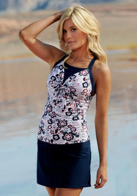 Bowtie Tankini  Nautical Flowers    Flattering gathers enhance the slimming effects that sculpt shapely curves and smooths away trouble spots. Two tone detail with a modest neckline provides support for both small and large chest, while offering a look similar to a halter style.