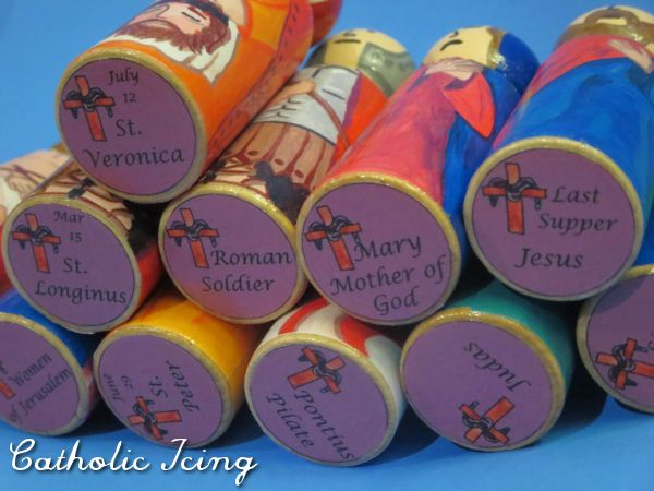 bottom of peg doll- label saint name and feast day