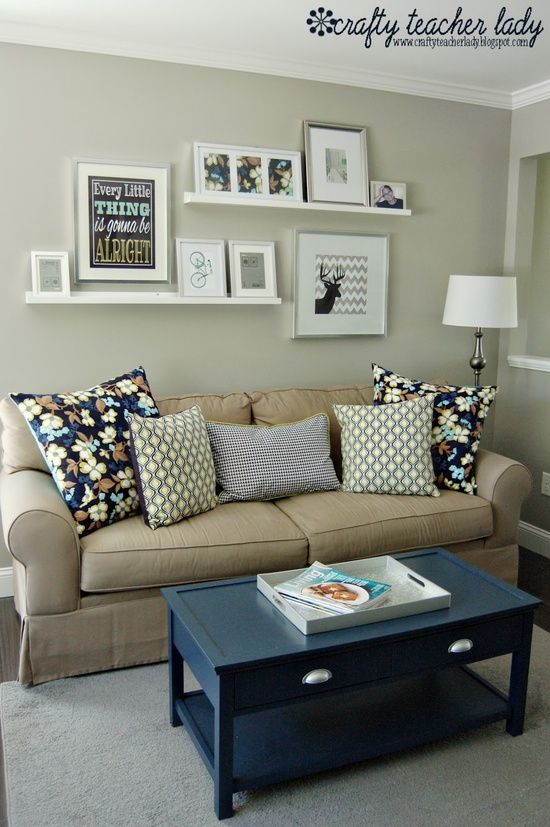 arrangement of ledges and photos above couch @ Do it Yourself Home Ideas