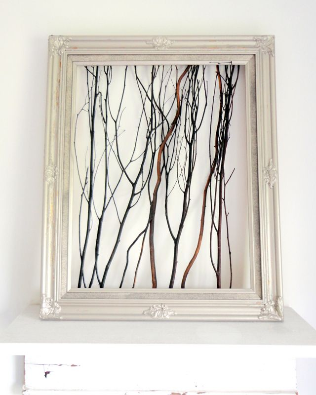 Use twigs, spray paint, and a cheap frame to create a rustic work of art for next to nothing!