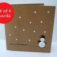 This cute and simple design features a button snowman with a hand drawn hat and arms and Christmas greeting on recycled brown Kraft card. The card has paper cut snow with a white insert. You will receive 4 cards and envelopes. Size: 135x135mm The Card ...