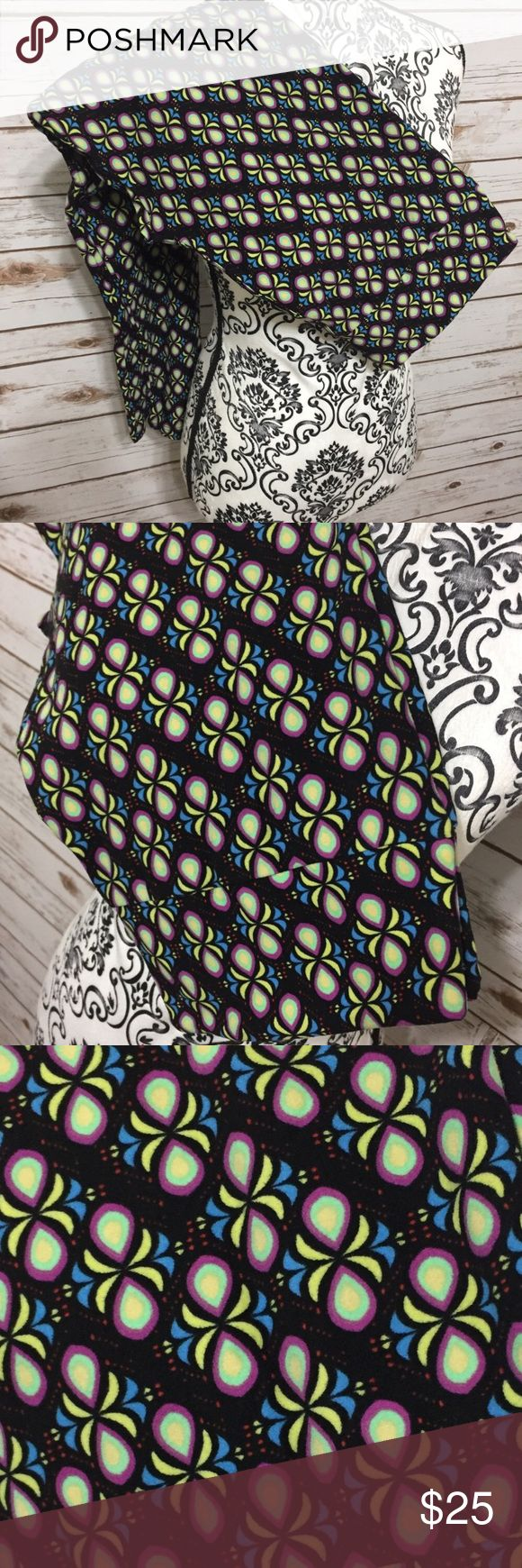 LuLaRoe TC Leggings LuLaRoe Tall & Curvy (TC) multi colored Leggings. Never worn, never tried on, NWT (if you know LLR leggings you know that although they're NEW, leggings DO NOT come with an actual tag since the tag since would ruin the fabric). There are cards, however you will only get a card if you buy TWO leggings. *I'm not a LuLaRoe Consultant! Offers are welcome but I don't trade. LuLaRoe Pants Leggings