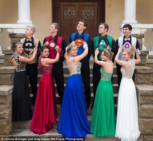 Our heroes! Teens from Arkansas chose superhero-themed ensembles for their prom last weekend (from left: Batman, Iron Man, Superman, Green Hornet, and Captain America)