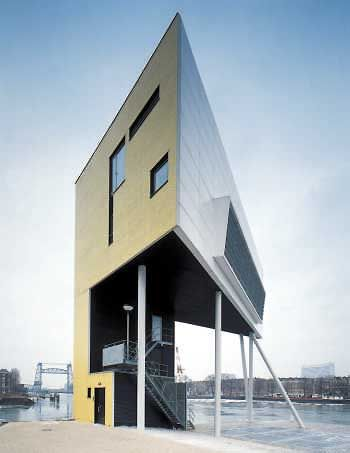 Designed by Architects Bolles-Wilson (Julia Bolles and Peter Wilson), and located next to the new Erasmus Bridge in the Netherlands, this residence serves a double purpose within three internal levels. Inside you will find the office and control rooms used by  harbor personnel responsible for operating the 8 Harbour Bridges and choreograph the shipping, as well as a small residential area.