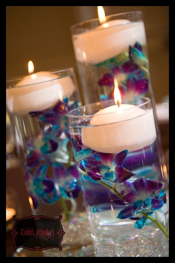 Purple and blue dendrobium orchids wedding centerpiece with candles