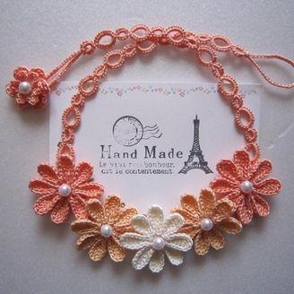 再販オレンジ色のお花ネックレス
