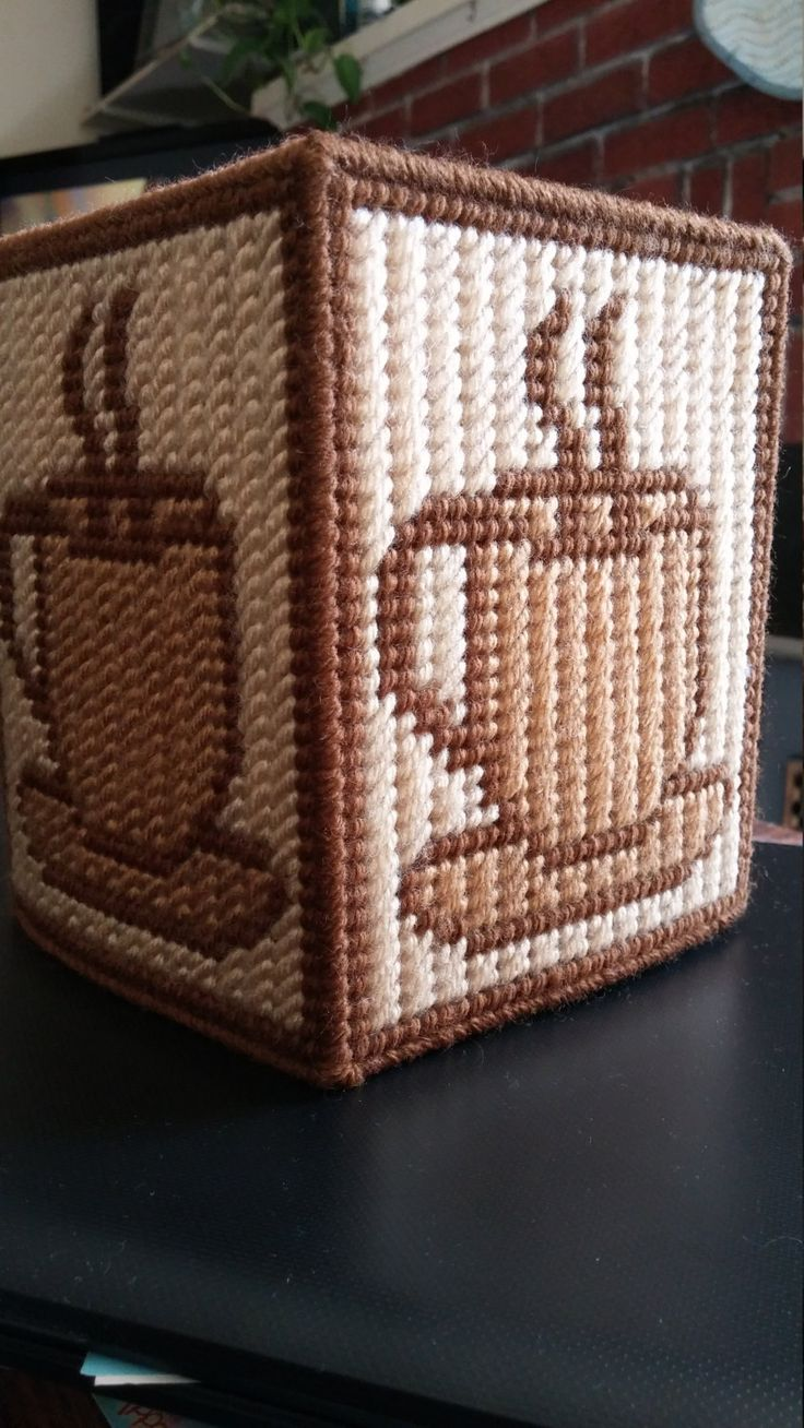 Coffee Tissue box cover...handmade in plastic canvas. Warm brown, light tan, and brown. Boutique tissue box included. This is already made by hand and ready to ship. As always, shipping is combined.