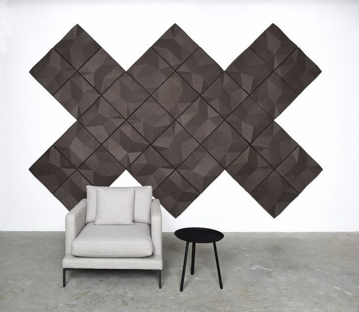 Ecoustic Matrix acoustic wall tiles in diagonal formation in Taupe. Chair from Homeware Gallery.