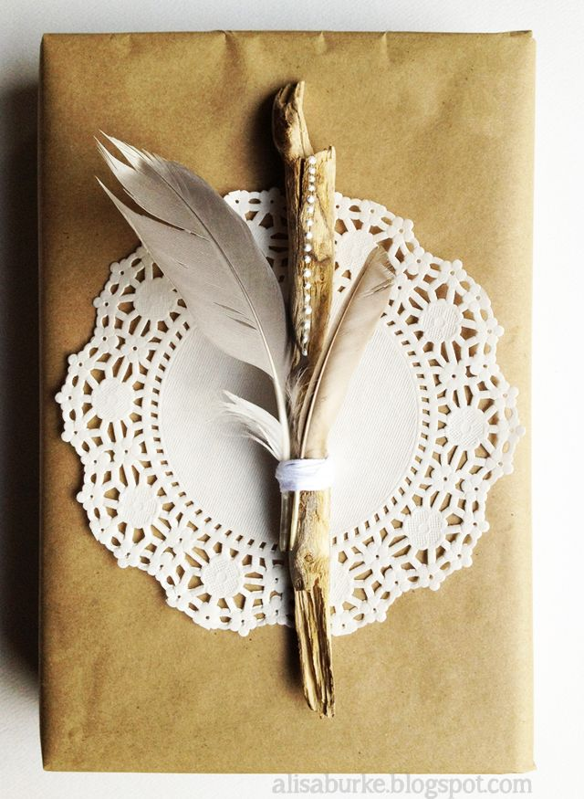 Doily wrapping with feathers.
