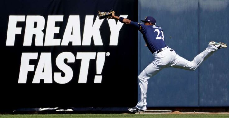 Freaky catch:    Keon Broxton of the Milwaukee Brewers makes a running catch during a spring training game against the Cincinnati Reds on March 1 in  Phoenix. Milwaukee won 3‐2.